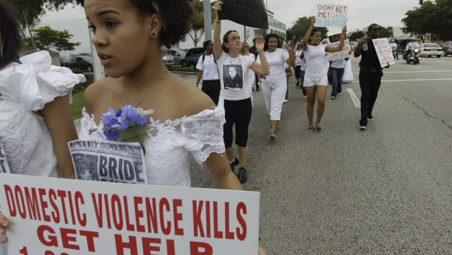 A 2011 photo shows people participating in Barry University's College Brides Walk, with many walking 7.5 miles in bridal gowns to bring awareness of domestic and dating violence.