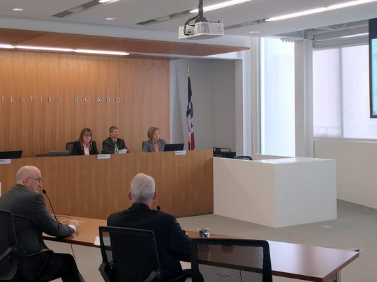 The Iowa Utilities Board and several staff are shown on May 17, 2016, at the board's meeting room at the Iowa Capitol complex.