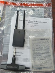 The remote skimmer device and a tool believed used for opening card readers. The evidence was found when officers stopped two men on Interstate 40 in Dickson.
