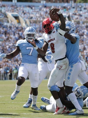 Louisville quarterback Lamar Jackson (8) scores against North Carolina during the second half of an NCAA college football game in Chapel Hill, N.C., Saturday, Sept. 9, 2017. Louisville won 47-35. (AP Photo/Gerry Broome)