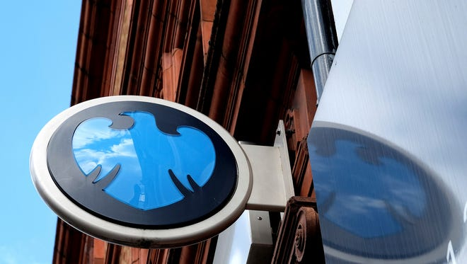FILE - In this Wednesday, April 27, 2016, file photo, the Barclays logo hangs on a branch of a Barclays Bank in London. Riding-sharing company Uber plans to launch its own credit card, partnering with the British bank Barclays. The card will be coming later in 2017, according to Barclays. (AP Photo/Kirsty Wigglesworth, File) ORG XMIT: NYBZ107