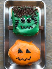 Frankenstein and pumpkin doughnuts from Boxcar are unfilled doughnuts with vanilla icing.