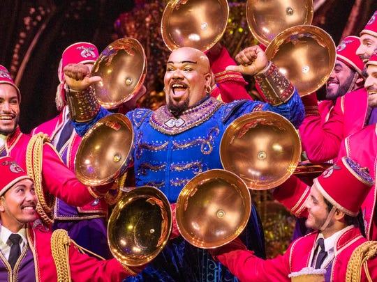 "Korie Lee Blossey (Genie) on stage in Disney's ""Aladdin."""