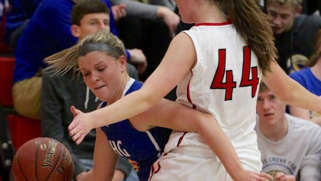 Howards Grove's Brittany Schaller dribbles around Oostburg's Ashlea Haag at Oostburg Tuesday.