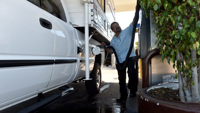 Jorge Fajardo, of Oxnard, takes advantage of low fuel prices to fill up his camper on Monday before the Thanksgiving holiday. Farjardo will be using the camper to travel for holiday.