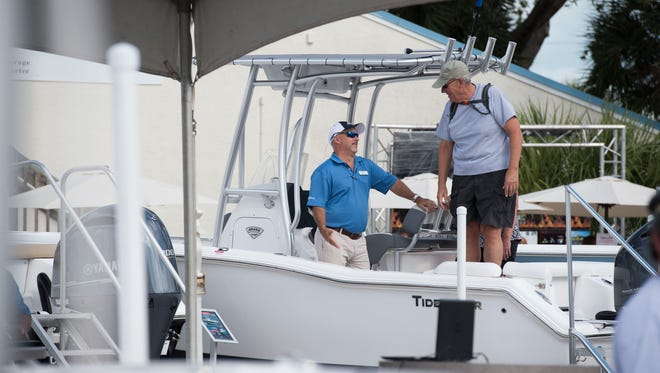 """Every year has gotten better. We have high expectations. This is a really good show,"" said Sundance Marine sales consultant Tony Rossell (left), about the 44th annual Stuart Boat Show on Friday, Jan. 12, 2018 along Old Dixie Highway in Stuart. The show features over 200 exhibitors selling boats, accessories, clothing, jewelry, fishing gear and more. The show continues 10 a.m. to 6 p.m. Saturday and 10 a.m. to 5 p.m. Sunday. For more information, go to stuartboatshow.com."