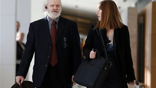 In this file photo, Wayne Sperling, left, arrives at court with his public defender at the Denver Justice Center, in Denver. Sperling, a father whose four young sons could communicate only in grunts when authorities rescued them from a filthy Denver apartment, faces up to seven years in prison when he is sentenced today.