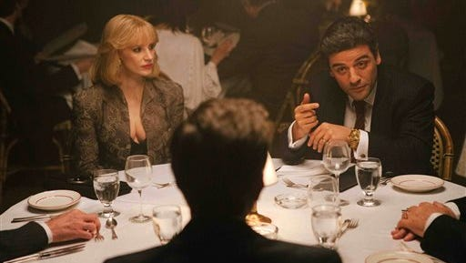"In this image released by courtesy of A24, Jessica Chastain, left, and Oscar Isaac appear in a scene from the film, ""A Most Violent Year.""  (AP Photo/A24, Atsushi Nishijima)"