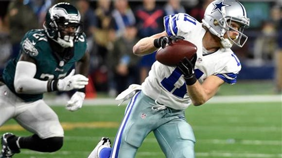 Malcolm Jenkins (27) chases Dallas Cowboys' receiver  Cole Beasley (11) after he makes a catch in the second half Sunday night.
