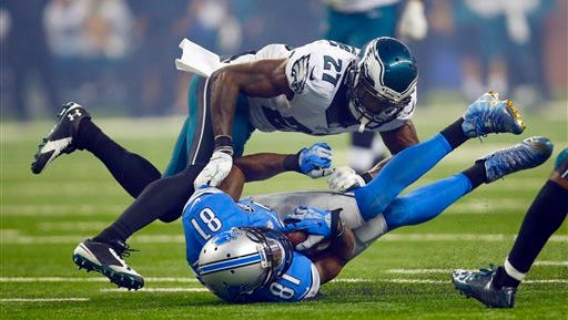 Eagles safety Malcolm Jenkins tackles the Lions' Calvin Johnson during the Eagles' 45-14 loss last Thursday. Johnson had three touchdown receptions for Detroit.