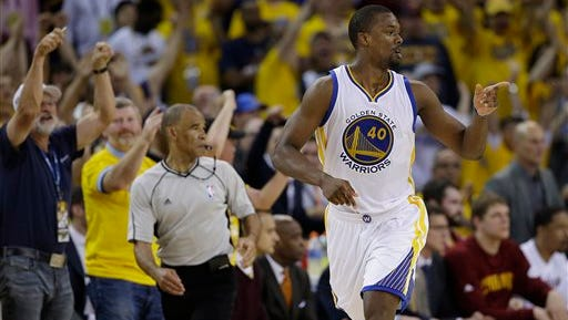 Golden State Warriors forward Harrison Barnes (40) gestures after scoring against the Cleveland Cavaliers during the second half of Game 7 of basketball's NBA Finals.