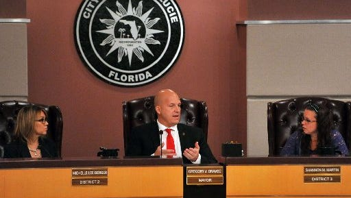 Port St. Lucie Mayor Gregory Oravec (center) talks with city council members Shannon Martin (right) and Michelle Berger at a meeting earlier this year. Mayor Greg Oravec and then-City Manager Jeff Bremer clashed over the city budget.