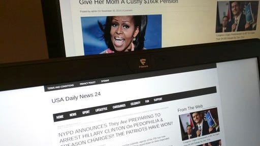 This photograph taken in Paris Friday Dec. 2, 2016 shows stories from USA Daily News 24, a fake news site registered in Veles, Macedonia. An Associated Press analysis using web intelligence service  Domain Tools shows that USA Daily News 24 is one of roughly 200 U.S.-oriented sites registered in Veles, which has emerged as the unlikely hub for the distribution of disinformation on Facebook. Both stories shown here are bogus. (AP Photo/Raphael Satter)​