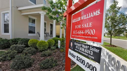 A sign hangs in front of a new home for sale in Riverview, Fla. Sales of new U.S. homes plunged in June, the Commerce Department said today, a sign that real estate continues to be a weak spot in the economy.