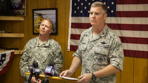 Brigadier General Timothy P. Williams, adjutant General of the Virginia National Guard, left, and Brigadier General Robert Brooks, component commander of the Massachusetts Air National Guard, answer questions from members of the media after announcing that the pilot who had been missing from an F-15 jet that crashed near Deerfield, Va. was found dead on Thursday.