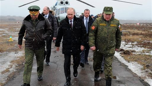 Russian President Vladimir Putin is dealing with the effects of slumping oil prices.