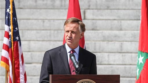 Gov. Bill Haslam speaks at a Memorial Day ceremony near the state Capitol in Nashville, Tenn., on Friday, May 23, 2014. The Republican governor a day earlier signed legislation into law that would allow the state to execute death row prisoners with the electric chair if lethal injection drugs become unavailable. (AP Photo/Erik Schelzig)