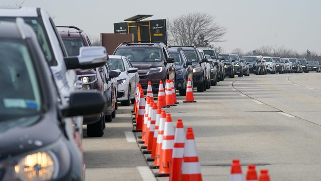 Cars line up to enter a COVID-19 drive-thru vaccination site Thursday at Jones Beach State Park in Wantagh, New York.