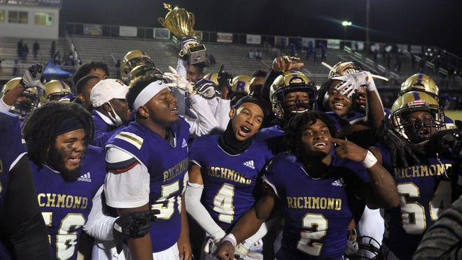 The Richmond Academy football team celebrates its region title on Friday, Nov. 20, 2020 at ARC Stadium. The Musketeers finished undefeated in the region for its first title since 1976.