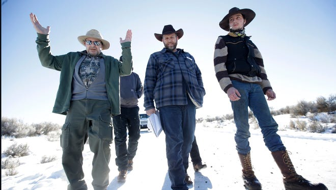 Burns resident Steve Atkins, left, talks with Ammon Bundy, center, at Malheur National Wildlife Refuge Friday, Jan. 8, 2016, near Burns, Ore.