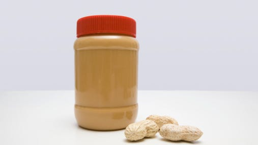 Jar of peanut butter and peanuts