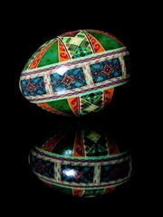 A rhea egg is decorated in traditional patterns and