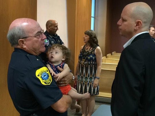 Interim Green Bay Police Chief Jim Lewis holds his