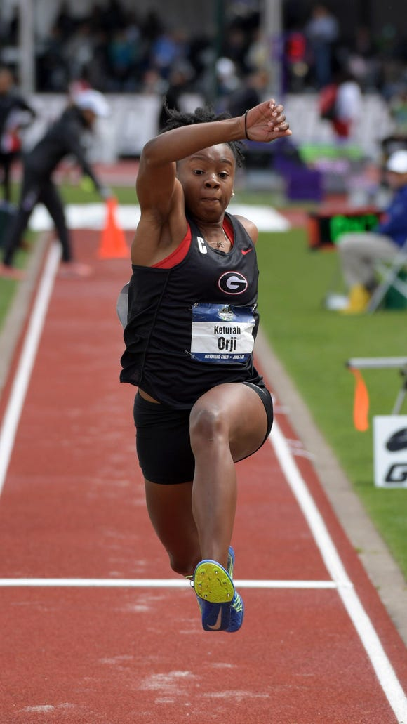 Georgia junior Keturah Orji, a Mount Olive alumna, wins the NCAA triple jump in a wind-aided 46-10 3/4 at Hayward Field.