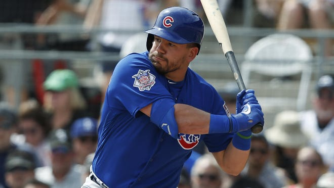 Chicago Cubs' Kyle Schwarber bats during a spring training baseball game against the Chicago White Sox Friday, March 15, 2019, in Glendale, Ariz.