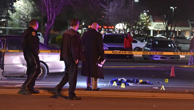 Officers investigate at the scene where an officer-involved shooting occurred at South McCarran Blvd. on Jan. 25, 2016.