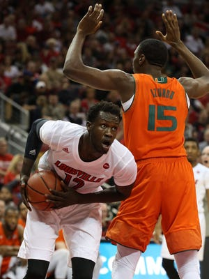 Mangok Mathiang goes low under the basket in the first half.Feb. 11, 2017