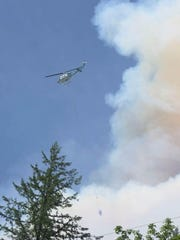 The Oregon Department of Forestry reported there was an approximately 30-acre wildfire burning Saturday, July 4, along Highway 22 near Big Cliff Dam and Detroit Lake Dam.