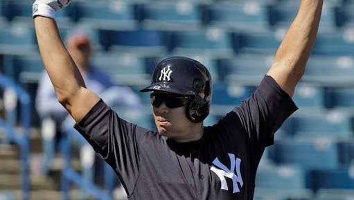 New York Yankees' Alex Rodriguez stretches before taking batting practice during a spring training baseball workout Saturday, Feb. 27, 2016, in Tampa, Fla.