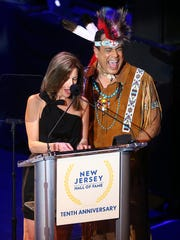Felip Rose of the Village People and New Jersey First Lady Tammy Murphy share a laugh during the 10th Anniversary Induction Ceremony of the New Jersey Hall of Fame at the Paramount Theater in Convention Hall, Asbury Park. May 6, 2018. Asbury Park, NJ  May 6, 2018. Asbury Park, NJ
