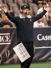 Arizona Rattlers head coach Kevin Guy argues for a