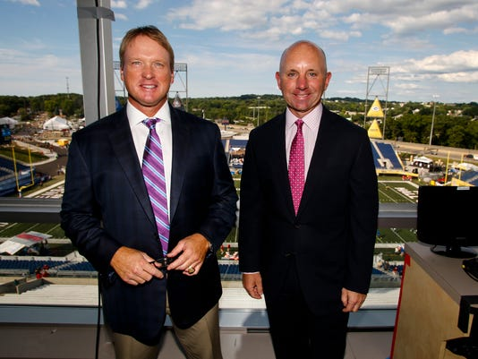 "FILE - In this Aug. 7, 2016, file photo, ESPN Monday Night Football announcers Jon Gruden, left, and Sean McDonough stand in the press box of Tom Benson Hall of Fame Stadium before a preseason NFL football game between the Green Bay Packers and the Indianapolis Colts, in Canton, Ohio. Eleven years after the network telecast an NFL game from Mexico City, it will do so again when the Raiders ""host"" the Texans on Monday night. Gruden has become something of a rock star in the NFL broadcasting world, and while his main job is to dissect play on the field, it will be intriguing to hear his take on not only the game, but the entire scene Monday night. (AP Photo/Gene Puskar, File)"