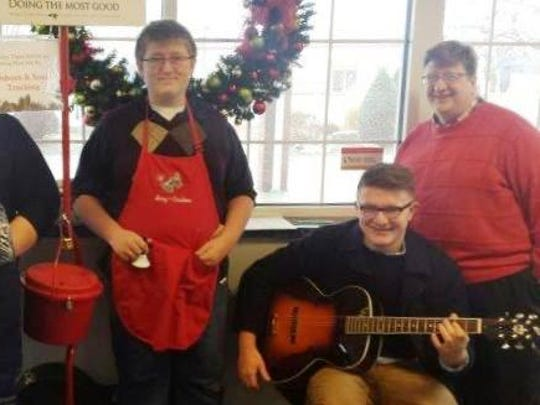 Sunny 97.7 morning show co-host Heather Linstrom and her family performed musical arrangements in December, alongside the Red Kettle at Schreiner's Restaurant.