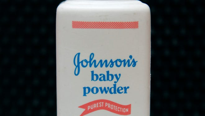 """A bottle of Johnson's baby powder. A Southern California jury has ordered Johnson & Johnson to pay more than $25 million to a woman who claimed in a lawsuit that she developed cancer by using the company's talc-based baby powder. Jurors on Thursday, May 24, 2018, awarded $4 million in punitive damages after finding that Johnson & Johnson acted with """"malice, oppression or fraud."""""""