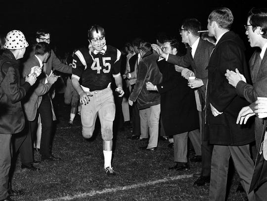 Vanderbilt sophomore Chip Healy (45) runs through a tunnel of fellow students before the start of a game against Florida on Oct. 1, 1966. Undefeated Florida used two touchdowns passes from Steve Spurrier to defeat the Commodores 13-0.