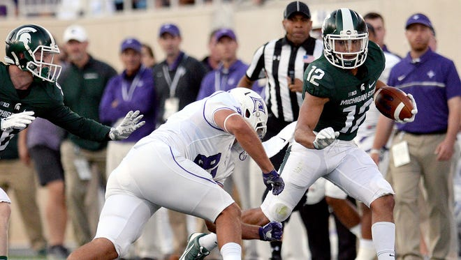 Michigan State University  senior receiver R.J. Shelton (12) tries to get around a Paladin defender in the first half of play against Furman in the Spartan's opening game of the 2016 season Friday, Sept. 2, in East Lansing.