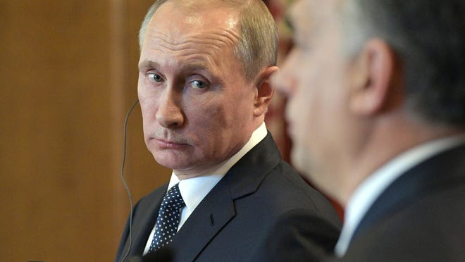 Russian President Vladimir Putin attends a joint news conference with Hungarian Prime Minister Viktor Orban at the parliament building in Budapest, Hungary.