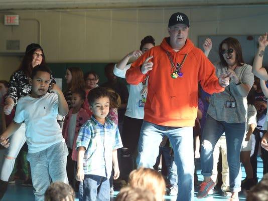 Principal dancing for charity