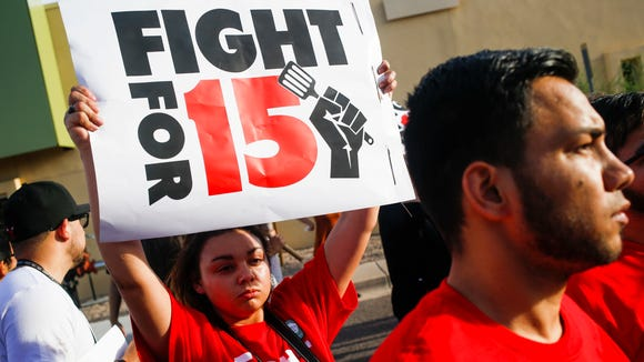 Protesters, activists and fast food workers march in