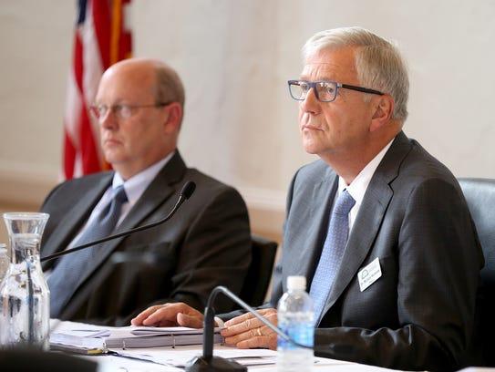 Iowa Board of Regents president Michael Richards listens