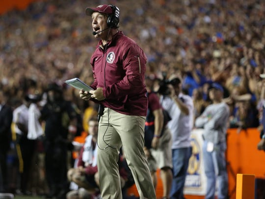 FSU Head Coach Jimbo Fisher yells to his team from the sideline during their game against Florida on Saturday Nov. 28, 2015 at Ben Hill Griffin Stadium.