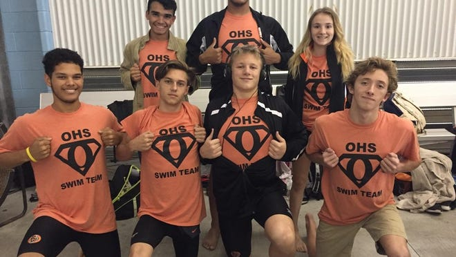 Coby Deville, McAllister Pritchett, Richard Fisher, TJ Pitre, Eric Fisher, Eddie Ramirez and Lydia Venable of the Opelousas High swim team pose for a photo at the recent district championships.