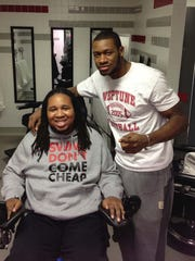 Tim Wright gives a haircut to Eric LeGrand, former
