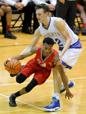 Bosse's Mekhi Lairy (2) drives past Castle's Jack Nunge (22) during the SIAC Tournament semifinals at North High School in Evansville, Thursday, Jan. 12, 2017. Castle beat Bosse 99-89.