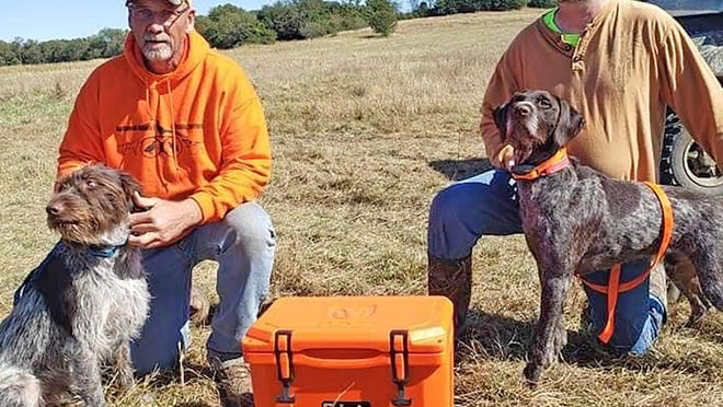 Bob Manning, right, and Sam Martin, of Topeka, show off their prized bird dogs during a previous National Upland Classic Series event.