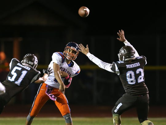 Penn Yan quarterback Will Rogers (7) stands in and delivers a pass in 2017, while under pressure from East Rochester/Gananda's Jack Duncan (51) and Rylee Moss (82).